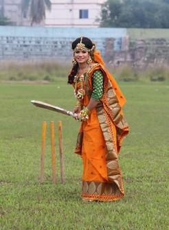 Bangladeshi cricketer Sanjida Islam poses as a bride with a cricket bat, a day before her wedding day in Rangpur, Bangladesh, on Oct. 16. (Sobhana Mostary via AP)