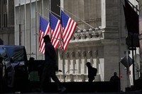 In this Oct. 14, 2020 file photo, pedestrians pass the New York Stock Exchange. (AP Photo/Frank Franklin II)