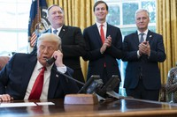 U.S. President Donald Trump talks on a phone call with the leaders of Sudan and Israel, as Secretary of State Mike Pompeo, left, White House senior adviser Jared Kushner, and National Security Adviser Robert O'Brien applaud in the Oval Office of the White House on Oct. 23, 2020, in Washington. (AP Photo/Alex Brandon)