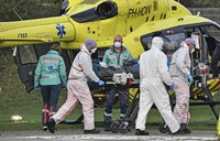 A COVID-19 patient from the Netherlands arrives for treatment by helicopter to the University hospital in Muenster, Germany, on Oct. 23, 2020. (AP Photo/Martin Meissner)