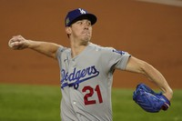 Los Angeles Dodgers starting pitcher Walker Buehler throws against the Tampa Bay Rays during the first inning in Game 3 of the baseball World Series on Oct. 23, 2020, in Arlington, Texas. (AP Photo/Tony Gutierrez)