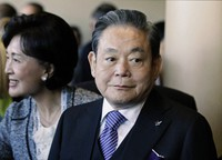 In this July 6, 2011, file photo, Samsung Chairman Lee Kun-hee, right, greets people from the South Korean delegation in Durban, South Africa, for the 123rd International Olympic Committee (IOC) session that will decide the host city for the 2018 Olympics Winter Games. (AP Photo/Schalk van Zuydam, File)