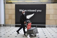 A passenger from New Zealand arrives at the International Airport in Sydney, Friday, Oct. 16, 2020. (Dean Lewins/AAP Image via AP)