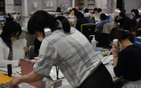In this file photo taken on May 13, 2020, employees at the city of Yamagata's public health center are seen responding to calls about the coronavirus. (Mainichi/Genta Fujimura)