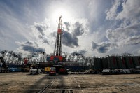 In this March 12, 2020 file photo, the sun shines through clouds above a shale gas drilling site in St. Mary's, Pa. (AP Photo/Keith Srakocic)