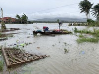 The remains of a house is surrounded by floods in Pola town on the island of Mindoro, central Philippines, Monday, Oct. 26, 2020. (AP Photo/Erik De Castro)
