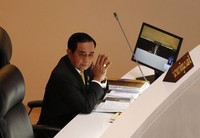 Thailand Prime Minister Prayuth Chan-ocha looks on during the special session at the parliament house in Bangkok, Thailand, on Oct. 26, 2020. (AP Photo/Sakchai Lalit)