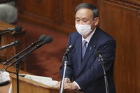 Japanese Prime Minister Yoshihide Suga delivers a policy speech during an extraordinary Diet session at the upper house of parliament in Tokyo, on Oct. 26, 2020. (AP Photo/Koji Sasahara)