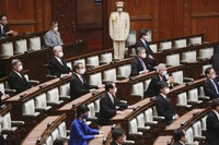 Japanese lawmakers wearing face masks to protect against the spread of the coronavirus attend an extraordinary Diet session at the upper house of parliament in Tokyo, on  Oct. 26, 2020. (AP Photo/Koji Sasahara)