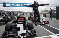 Mercedes driver Lewis Hamilton of Britain jumps out of his car after his record breaking 92nd win at the Formula One Portuguese Grand Prix at the Algarve International Circuit in Portimao, Portugal, on Oct. 25, 2020. (Jorge Guerrero, Pool via AP)