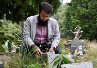 Saeed Zafar is seen on Oct. 16, 2020, mourning his first son who was buried in a Catholic cemetery in Beppu, Oita Prefecture. (Mainichi/Tomohiro Tsujimoto)