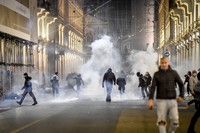 Smoke billows as clashes broke out during a protest against the government restriction measures to curb the spread of COVID-19 in Turin, Italy, on Oct. 26, 2020. (Claudio Furlan/LaPresse via AP)