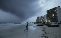 Clouds gather over Playa Gaviota Azul as Tropical Storm Zeta approaches Cancun, Mexico, on Oct. 26, 2020. (AP Photo/Victor Ruiz Garcia)