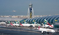 In this Dec. 11, 2019 file photo, an Emirates jetliner comes in for landing at Dubai International Airport in Dubai, United Arab Emirates. (AP Photo/Jon Gambrell)