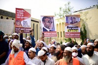 Supporters of Islami Andolan Bangladesh, an Islamist political party, hold posters of French President Emmanuel Macron as they protest against the publishing of caricatures of the Prophet Muhammad they deem blasphemous, in Dhaka, Bangladesh, on Oct. 27, 2020. (AP Photo/Mahmud Hossain Opu)