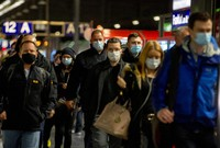 Commuters, wearing face masks to help curb the spread of the coronavirus, arrive in the main train station in Frankfurt, Germany, on Oct. 27, 2020. (AP Photo/Michael Probst)