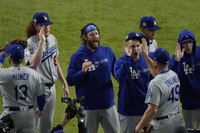 Los Angeles Dodgers starting pitcher Clayton Kershaw, center, celebrates after their win against the Tampa Bay Rays in Game 5 of the baseball World Series on Oct. 25, 2020, in Arlington, Texas. (AP Photo/Sue Ogrocki)