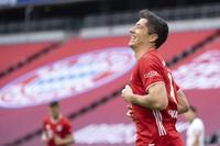 Robert Lewandowski of Munich celebrates his side's 2nd goal during a German Bundesliga soccer match between Bayern Munich and Eintracht Frankfurt in Munich, Gdermany, on Oct.24, 2020. (Matthias Balk/dpa via AP)