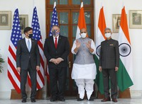 U.S. Secretary of State Mike Pompeo, second from left, and Secretary of Defence Mark Esper, left, stand for photos with Indian Foreign Minister Subrahmanyam Jaishankar, right, and Defence Minister Rajnath Singh ahead of their meeting at Hyderabad House in New Delhi, India, on Oct. 27, 2020. (Adnan Abidi/Pool via AP)
