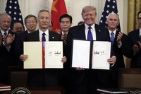 In this Jan. 15, 2020 file photo, U.S. President Donald Trump holds a trade agreement with Chinese Vice Premier Liu He, in the East Room of the White House in Washington. (AP Photo/Evan Vucci)