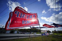 Trump campaign banners wave in the wind along Route 8 in Middlesex Township, Pa., in conservative Butler County on Oct. 15, 2020. (AP Photo/Gene J. Puskar)