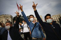 Demonstrators chant slogans during an anti-France protest in Istanbul, on Oct. 25, 2020. (AP Photo/Emrah Gurel)