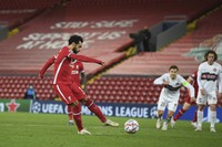 Liverpool's Mohamed Salah scores his side's second goal from a penalty during the Champions League Group D soccer match between Liverpool and FC Midtjylland at Anfield stadium, in Liverpool, U.K., on Oct. 27, 2020. (Michael Regan/Pool via AP)