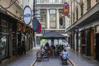 Outdoor diners are seen at a popular laneway cafe precinct in Melbourne, Australia, on Oct. 28, 2020. (AP Photo/Asanka Brendon Ratnayake)