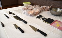Chunks of pork and kitchen knives confiscated from an apartment in Ota, Gunma Prefecture, are seen in this photo taken at the prefectural police's Ota Police Station on Oct. 28, 2020. Four Vietnamese men living in the apartment were arrested the same day. (Mainichi/Hinako Kikuchi)