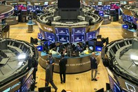 In this photo provided by the New York Stock Exchange, traders work on the floor during the MediaAlpha IPO, on Oct. 28, 2020.  (Courtney Crow/New York Stock Exchange via AP)