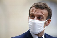 France's President Emmanuel Macron wears a mask during a speech of Estonia's Prime Minister Juri Ratas, at the Elysee Palace, in Paris, on Oct. 28, 2020.  (AP Photo/Thibault Camus)