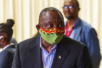 In this April 24, 2020 file photo, South African President Cyril Ramaphosa visits a field hospital in Johannesburg. (AP Photo/Jerome Delay)