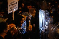 Protesters confront police during a march, on Oct. 27, 2020, in Philadelphia. (AP Photo/Matt Slocum)