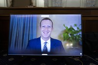 Facebook CEO Mark Zuckerberg appears on a screen as he speaks remotely during a hearing before the Senate Commerce Committee on Capitol Hill on Oct. 28, 2020, in Washington. (Michael Reynolds/Pool via AP)