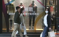 People wear face masks to protect against the spread of the coronavirus as they walk through a shopping district in Taipei, Taiwan, on Oct. 29, 2020. (AP Photo/Chiang Ying-ying)