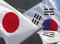 File photo of the national flags of Japan and South Korea. (Kyodo)
