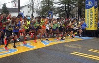 In this April 15, 2019, file photo, the elite men break from the start of the 123rd Boston Marathon in Hopkinton, Mass. Next year's Boston Marathon has been postponed. (AP Photo/Stew Milne)