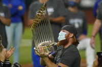 Los Angeles Dodgers third baseman Justin Turner celebrates with the trophy after defeating the Tampa Bay Rays 3-1 to win the baseball World Series in Game 6 on Oct. 27, 2020, in Arlington, Texas. (AP Photo/Eric Gay)
