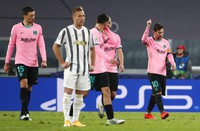 Barcelona's Lionel Messi, right, celebrates after scoring his side's second goal during the Champions League group G soccer match between Juventus and Barcelona at the Allianz stadium in Turin, Italy, on Oct. 28, 2020. (AP Photo/Antonio Calanni)