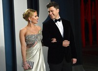In this Feb. 9, 2020 file photo, Scarlett Johansson, left, and Colin Jost arrive at the Vanity Fair Oscar Party in Beverly Hills, Calif. (Photo by Evan Agostini/Invision/AP)