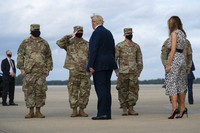 President Donald Trump and first lady Melania Trump arrive at Pope Army Field for an event with troops at Fort Bragg, on Oct. 29, 2020, in Pope Field, N.C. (AP Photo/Evan Vucci)