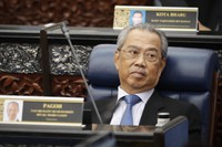 In this July 13, 2020 file photo, Malaysian Prime Minister Muhyiddin Yassin attends a parliament session at lower house in Kuala Lumpur, Malaysia. (AP Photo/Vincent Thian)