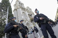 French police officers stand near Notre Dame church in Nice, southern France, on Oct. 29, 2020. (Eric Gaillard/Pool via AP)