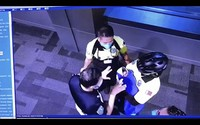 This image made from a surveillance camera footage on Oct. 2, 2020, obtained by the website Doha News, shows officials care for an abandoned baby at Hamad International Airport in Doha, Qatar. (Doha News via AP)