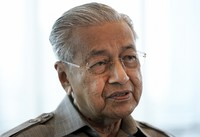 In this Sept. 4, 2020 file photo, former Prime Minister Mahathir Mohamad speaks during an interview with The Associated Press in Kuala Lumpur. (AP Photo/Vincent Thian)
