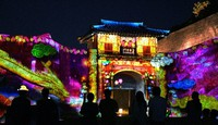 Images featuring Okinawa's Ryukyu Kingdom are seen projected on remaining structures at Shuri Castle in the city of Naha, Okinawa Prefecture, on Oct. 30, 2020. (Mainichi/Noriko Tokuno)