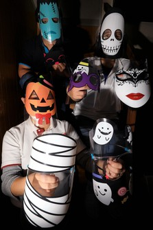 Kiyomi Tsugawa, president of printing company Handa, foreground, and others wear Halloween-themed face shields in the city of Niiza, Saitama Prefecture, north of Tokyo, on Oct. 27, 2020. (Mainichi/Naotsune Umemura)