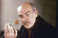 In this Jan. 23, 1987 file photo, actor Sean Connery holds a rose in his hand as he talks about his new movie