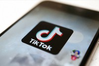 This Sept. 28, 2020, file photo, shows a logo of smartphone app TikTok on a user post on a smartphone screen in Tokyo. (AP Photo/Kiichiro Sato)