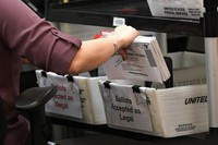 In this Oct. 26, 2020, file photo, an election worker sorts vote-by-mail ballots at the Miami-Dade County Board of Elections, in Doral, Fla. (AP Photo/Lynne Sladky)